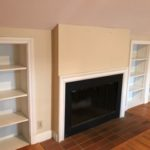 shelves and fireplce